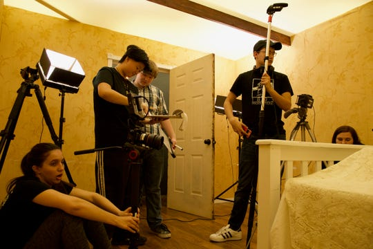 "Central High School students in the International Baccalaureate film course working on a 12-minute film, ""The Yellow Wallpaper,"" which won awards at numerous festivals."