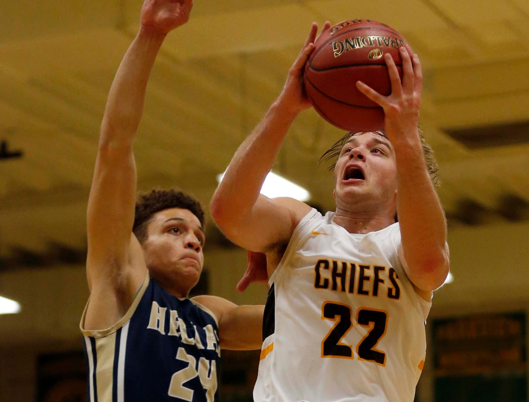 Kickapoo's Tanner Oetting looks to score against Helias in Springfield on November 29, 2018