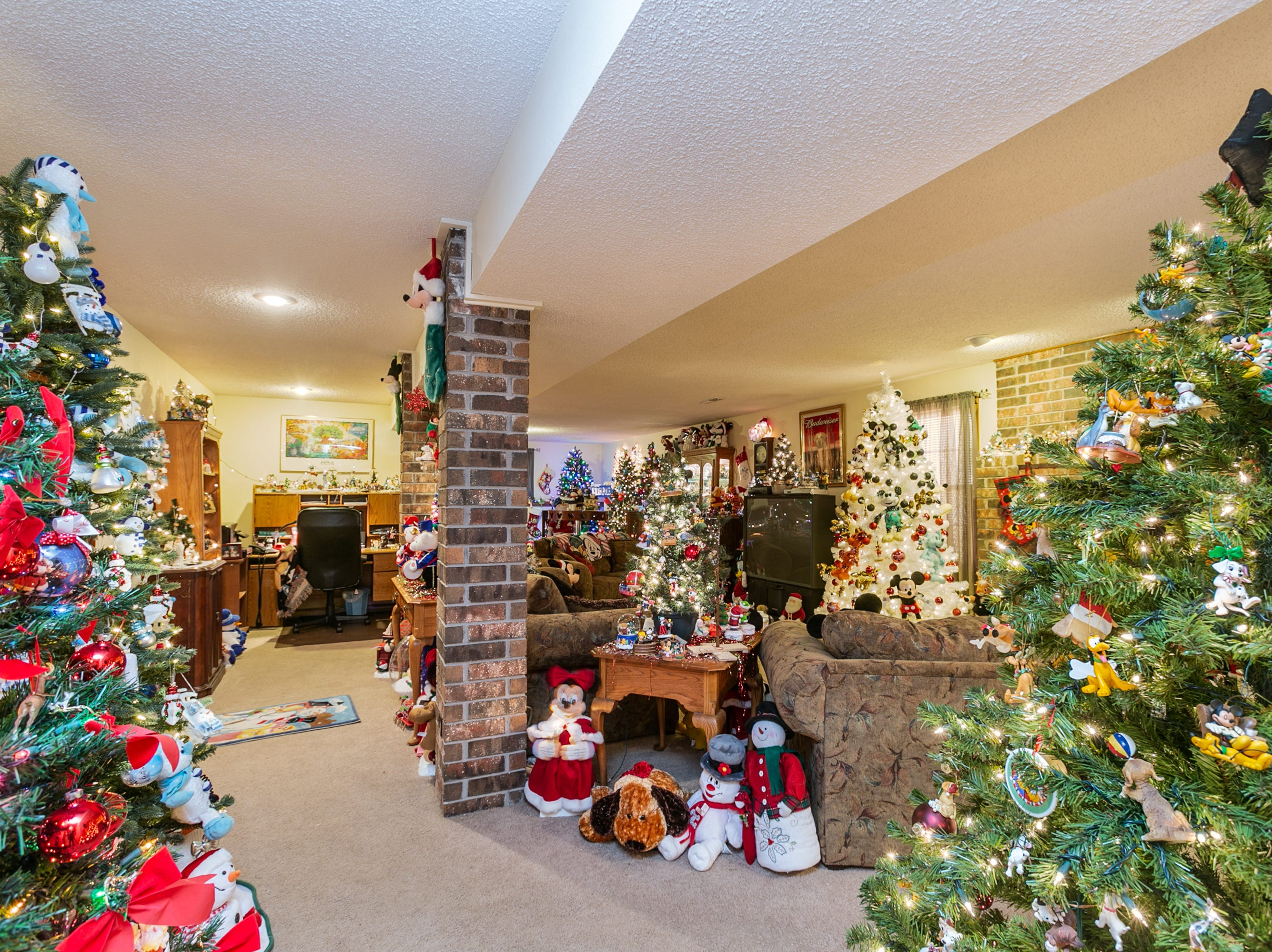 The basement is where the magic really happens. Donna has filled as many square inches as possible with Christmas décor. The white tree in the background features 90th anniversary Mickey plush toys and ornaments.