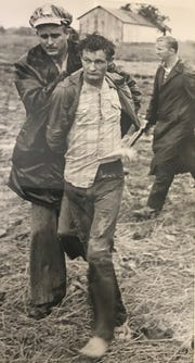 In this News-Leader file photo, Lt. Bill Boatman hustles Russell Maggard, 22. to jail. Maggard plead guilty to murdering deputy Jerry Inman. Inman's partner Marty Pettit spoke with the News-Leader on Friday.