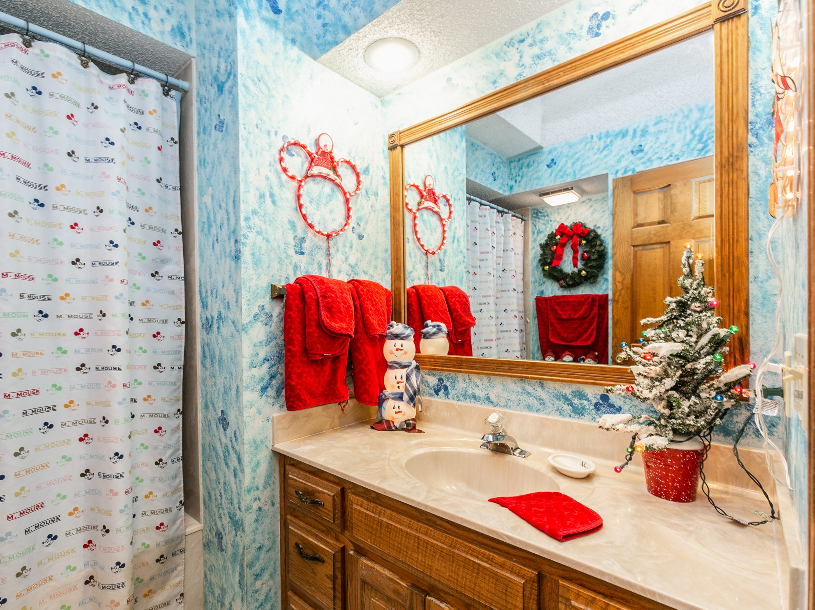 No room escapes holiday décor. The guest bath carries a subtle Mickey theme all year round in its paint job.