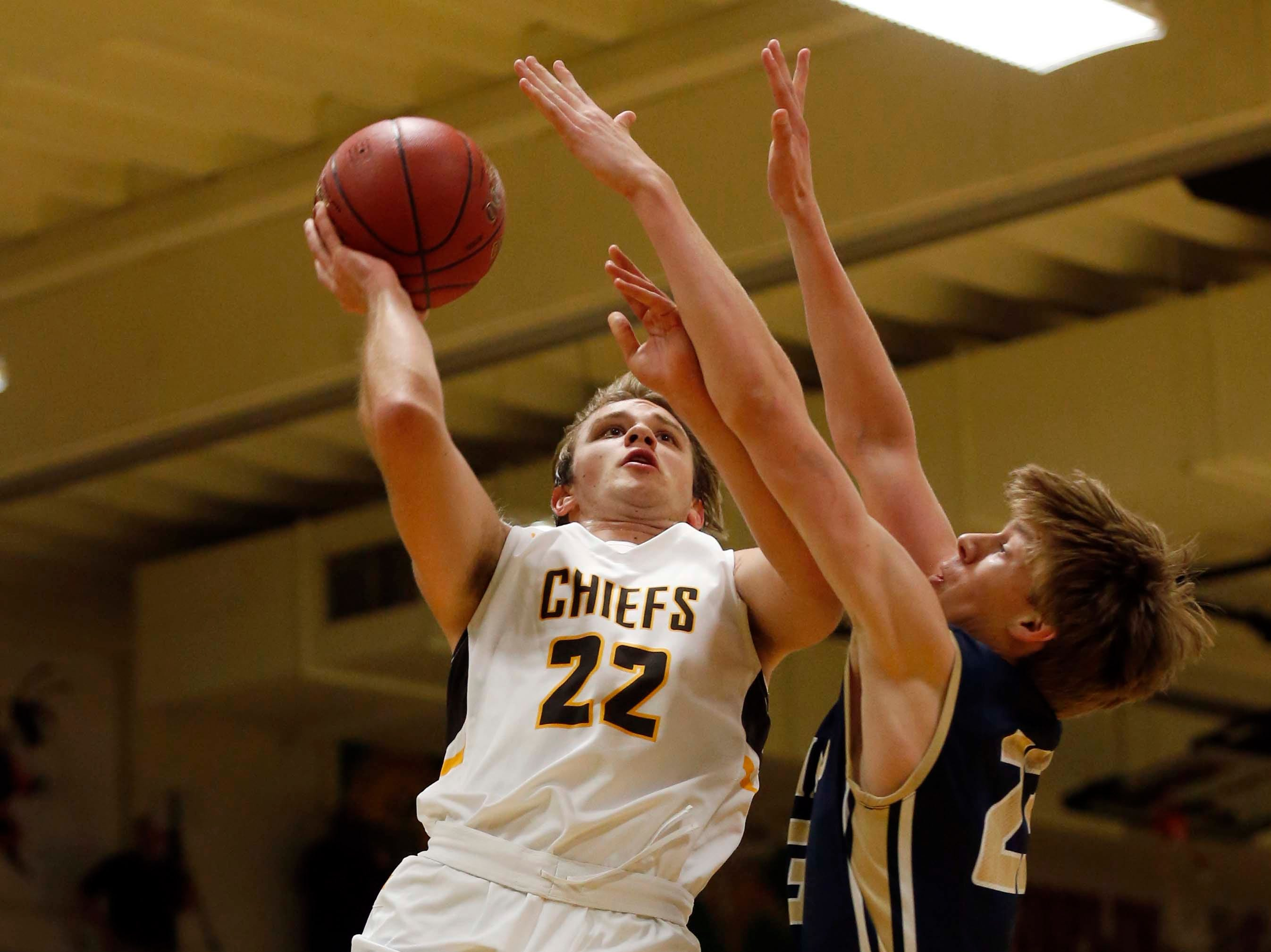 Kickapoo's Tanner Oetting looks to score against Helias in Springfield on November 29, 2018.
