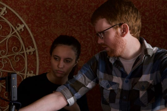 "Lauren Saiko, a student, and Josh Cantrell, the film adviser, working on ""The Yellow Wallpaper"" in early 2017."