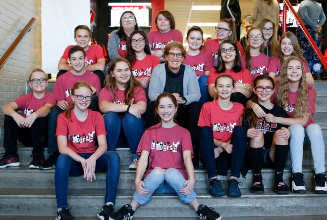Reed Academy Principal Debbie Grega with students from the leadership class Thursday. Grega is retiring after 12 years leading the middle school.