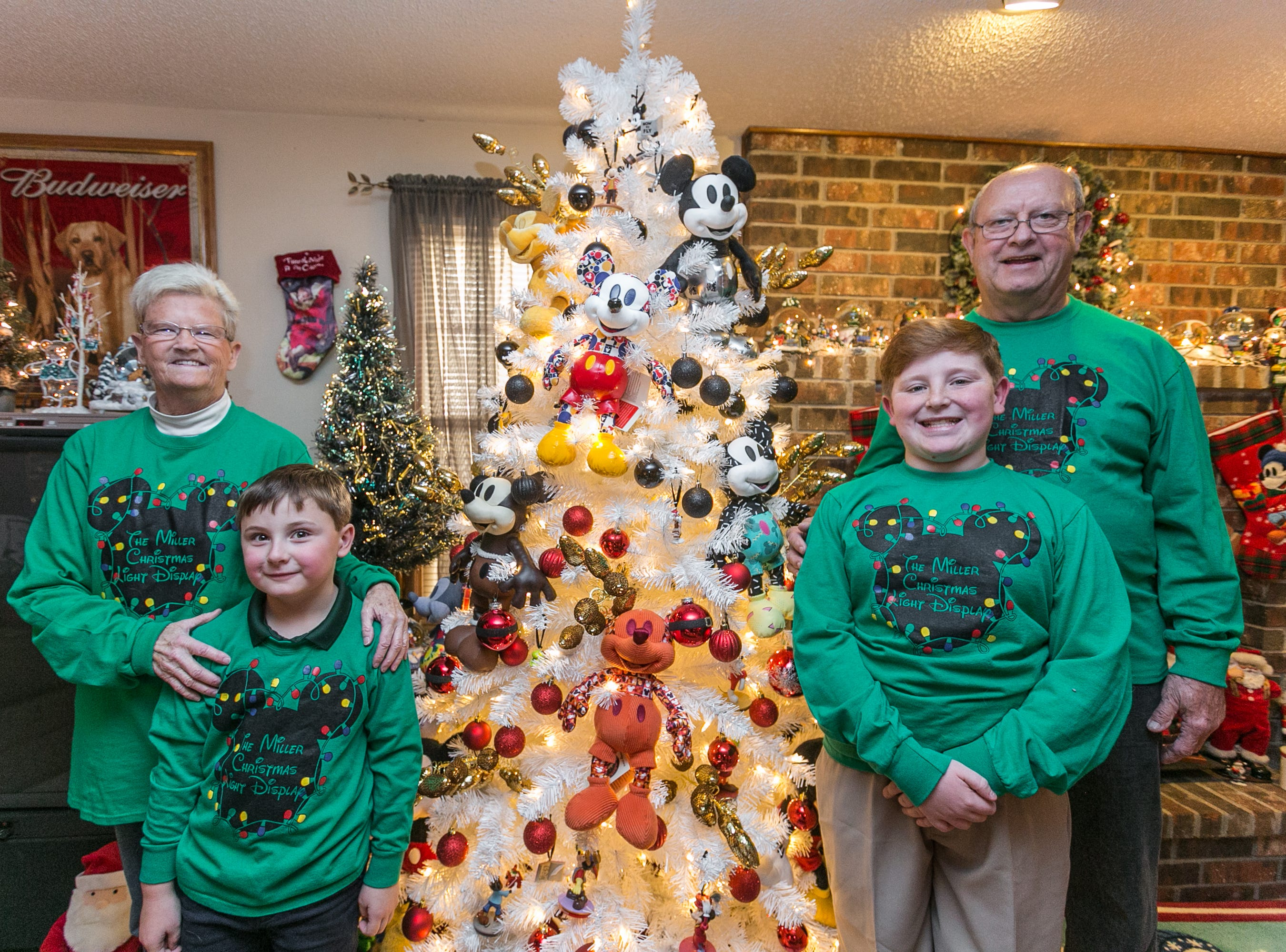 Donna and Paul Miller decorate their home in an elaborate Disney theme each year in large part for grandsons Wyler, left,  and Brody Tillman.
