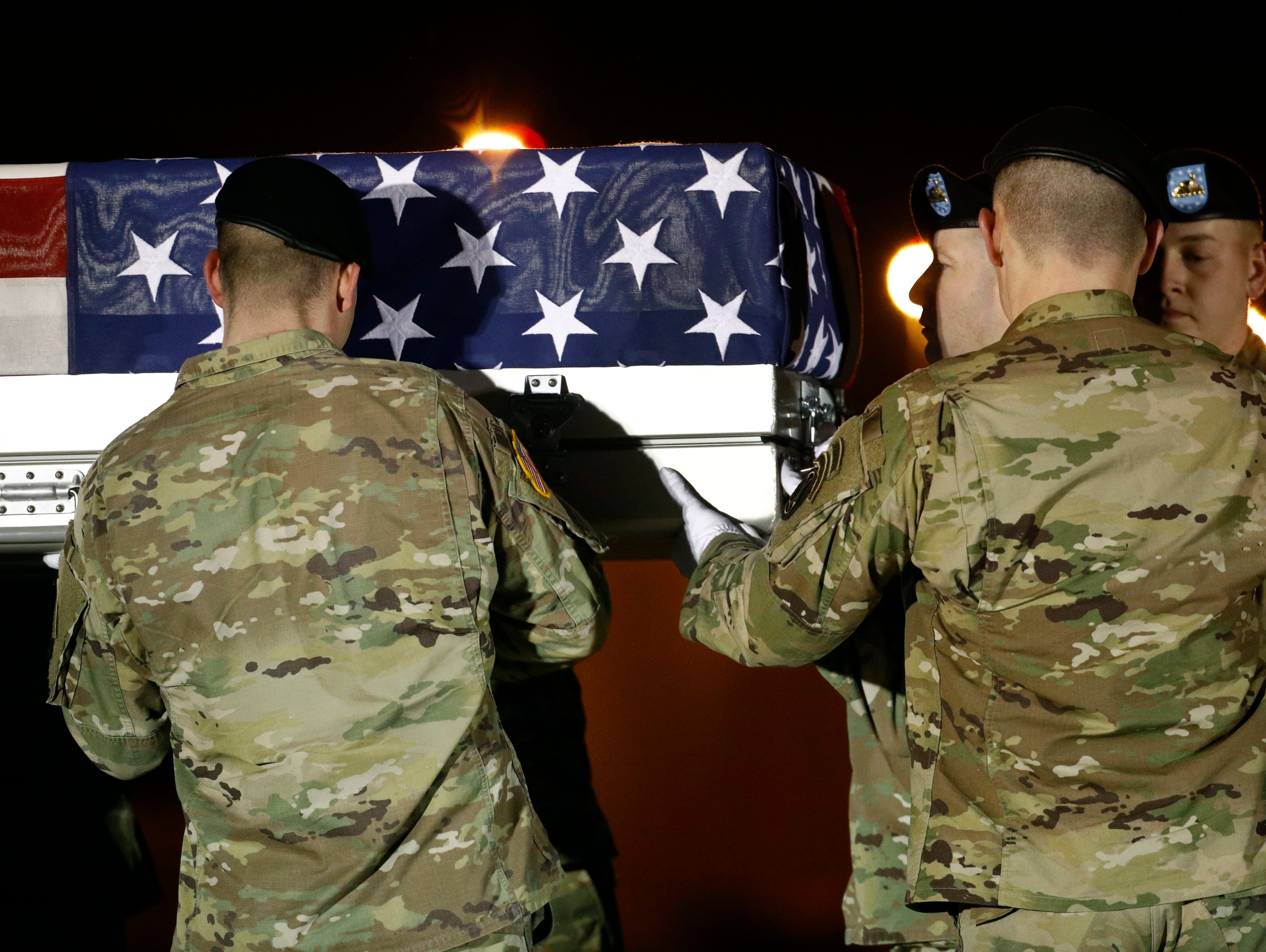 A U.S. Army carry team loads a transfer case containing the remains of Capt. Andrew P. Ross into a vehicle, Friday, Nov. 30, 2018, at Dover Air Force Base, Del. According to the Department of Defense, Ross, 29, of Lexington, Va., was killed Nov. 27, 2018, by a roadside bomb in Andar, Ghazni Province, Afghanistan.