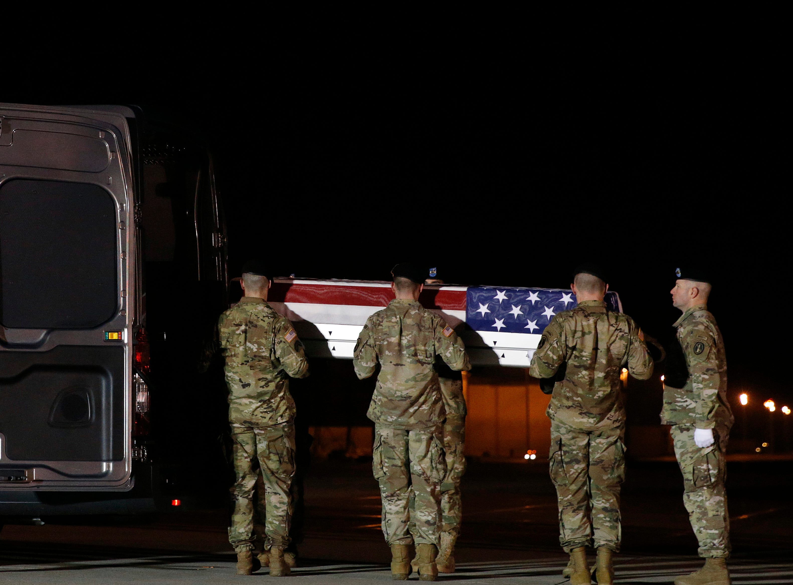 A U.S. Army carry team prepares to place a transfer case containing the remains of Capt. Andrew P. Ross into a vehicle, Friday, Nov. 30, 2018, at Dover Air Force Base, Del. According to the Department of Defense, Ross, 29, of Lexington, Va., was killed Nov. 27, 2018, by a roadside bomb in Andar, Ghazni Province, Afghanistan.