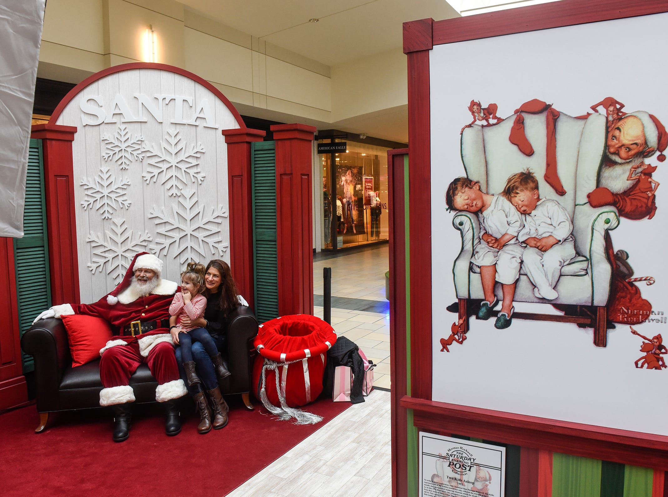 Classic Santa-themed artwork surrounds the Santa Claus set Friday, Nov. 30, at Crossroads Center in St. Cloud.