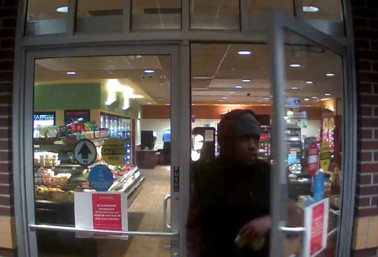 St. Cloud police released still photos of the suspect which were obtained from Kwik Trip surveillance video.
