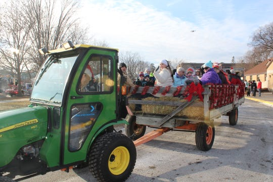 Families enjoy a hayride during a previous Nights and Lights Festival.