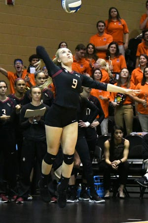 FSU defensive specialist Madison Sullivan (9) jump serves against the Florida Gators. The Seminoles fell 3-0 to their in-state rival in the first round of the NCAA Volleyball Tournament on Nov. 28 in Orlando.
