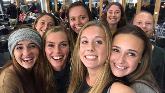 Chiles' girls cross country team takes a photo with former FSU star Colleen Quigley (second from bottom left) during a trip to Nike Cross Nationals in Portland, Oregon.