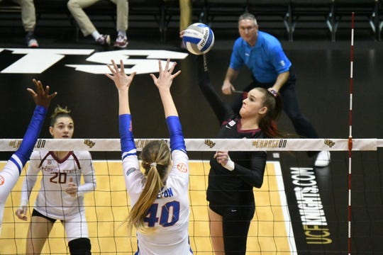 ACC Player of the Year Payton Caffrey (15) goes for a kill. The Seminoles fell 3-0 to Florida Gators in the first round of the NCAA Tournament in Orlando.