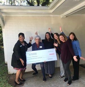From left:  Fadrien Sutton, Mary Kay Foundation Ambassador and Refuge House staff - Meg Baldwin, Emily Mitchem, Sheila McGraw, Dina Franklin, Lisa Tessier with donation.