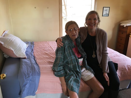 Callaway resident Anita Sessions (left), pictured with volunteer Theresa Prejean, receives a new mattress from a Tallahassee family after her old one was soaked during Hurricane Michael.