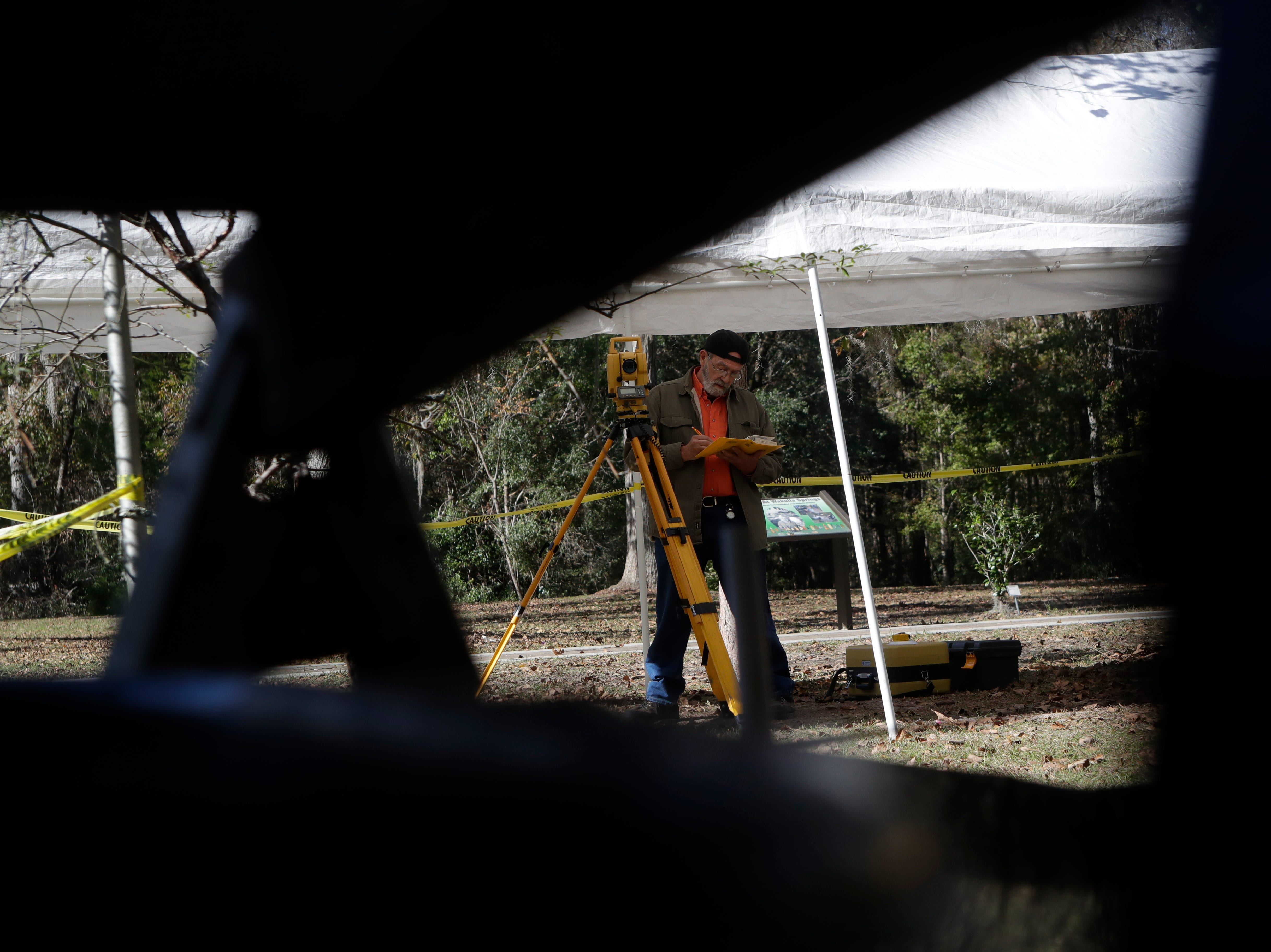 Aucilla Research Institute Archaeologist Gerald Brinkley measures the elevation above sea level of the pit during an archaeological dig being conducted by the Aucilla Research Institute at Wakulla Springs State Park Thursday, Nov. 29, 2018.