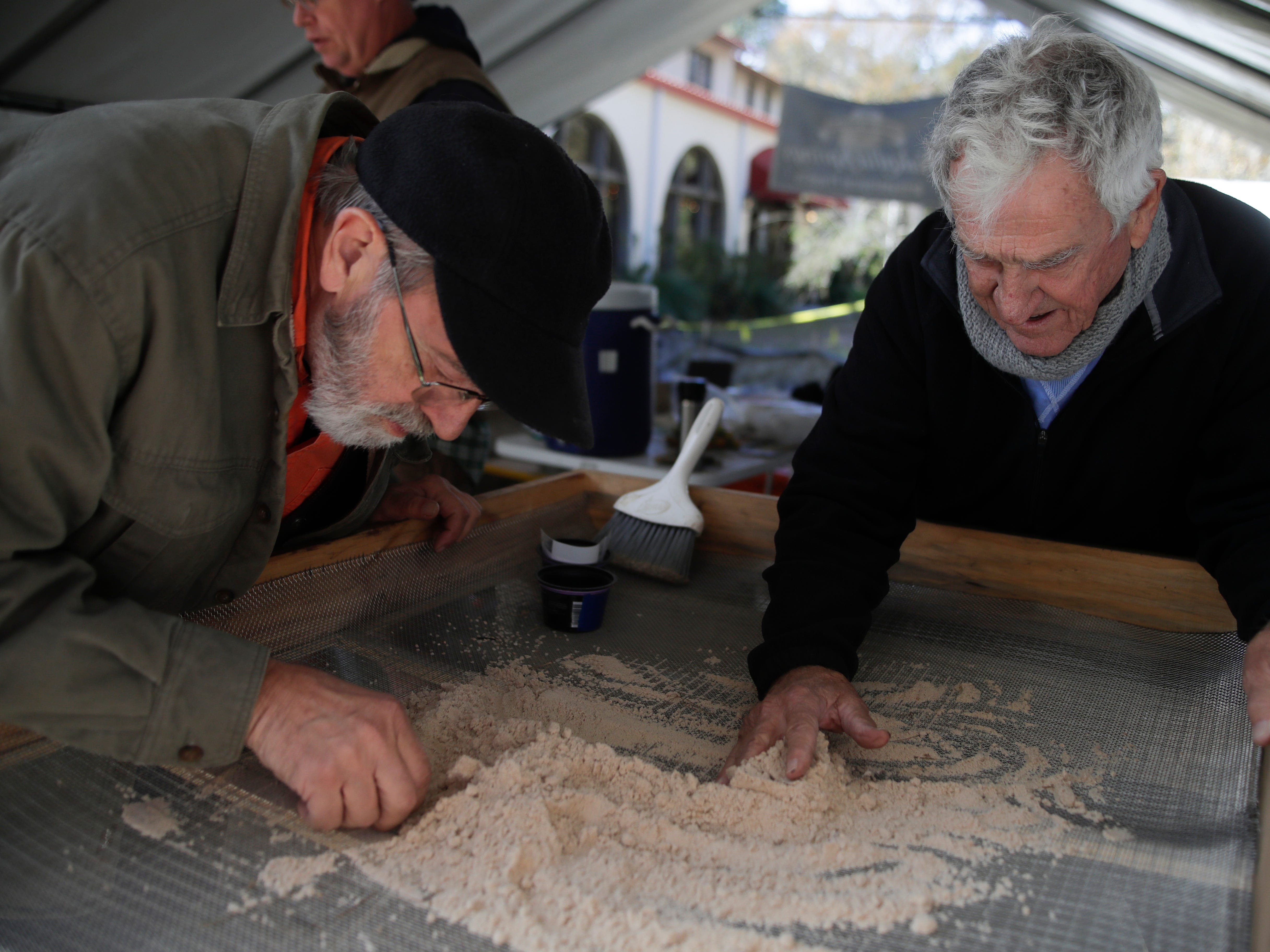 Aucilla Research Institute archaeologist Gerald Brinkley, left, and volunteer screener Ken Beattie look for artifacts in sand from the pit at Wakullla Springs State Park Thursday, Nov. 29, 2018.