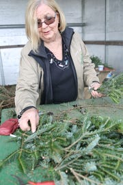 Havana Christmas Tree Farm owner Linda Sellars puts together a wreath. She sells about 60 wreaths and 400 feet of garland, all handmade, in the six or seven weeks before Christmas.