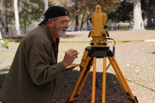 Aucilla Research Institute Archaeologist Gerald Brinkley measures the elevation above sea level of the pit during an archaeological dig being conducted by the Auscilla Research Institute at Wakulla Springs State Park Thursday, Nov. 29, 2018.