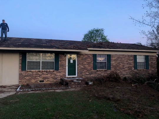The same Altha home, pictured above, fixed after Mission 850 volunteers helped remove the that fell on the roof.