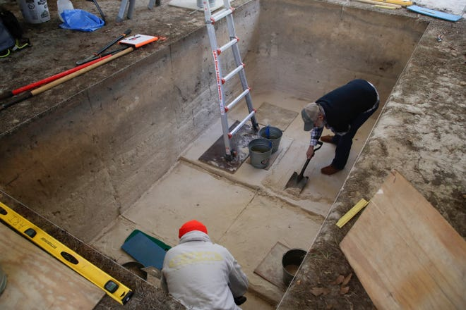 Board member Tom Harmon, right and crew chief Philip Gerrell shave sand from the bottom of the pit during an archaeological dig being conducted by the Aucilla Research Institute at Wakulla Springs State Park Thursday, Nov. 29, 2018.