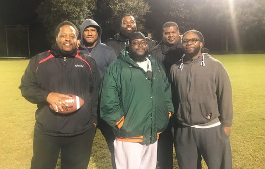 The coaching staff for the Chaires Eagles Pop Warner team has guided the squad to excellence. From left to right: Jarrod Acoff, Lorenzo Monix, Brandon Mickens, Montroy Williams, Tremaine Hughes and Jesse Lockhart.