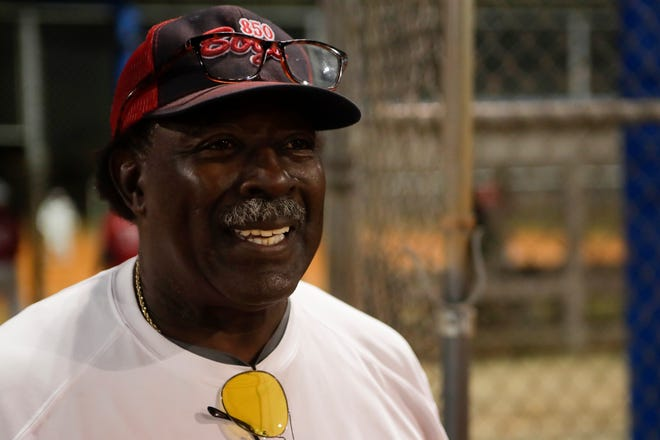 850 Boys manager Willie Ellis smiles as his team prepares to start a softball game Thursday, Nov. 29 at the Messer Sports Complex. The 850 Boys, a team of 60 year old players, will compete in the Florida Half Century Softball Association tournament in Mulberry.