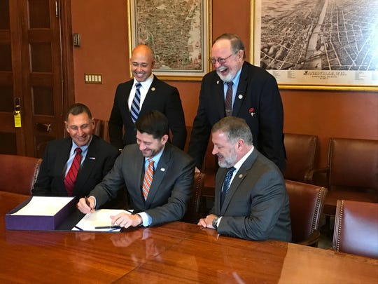 Clockwise from back left: U.S. Reps. Brian Mast, Don Young, Frank LoBiondo, Paul Ryan and Bill Shuster meet for the signing of the Frank LoBiondo Coast Guard Authorization Act of 2018 in the Capitol on Nov. 30, 2018.