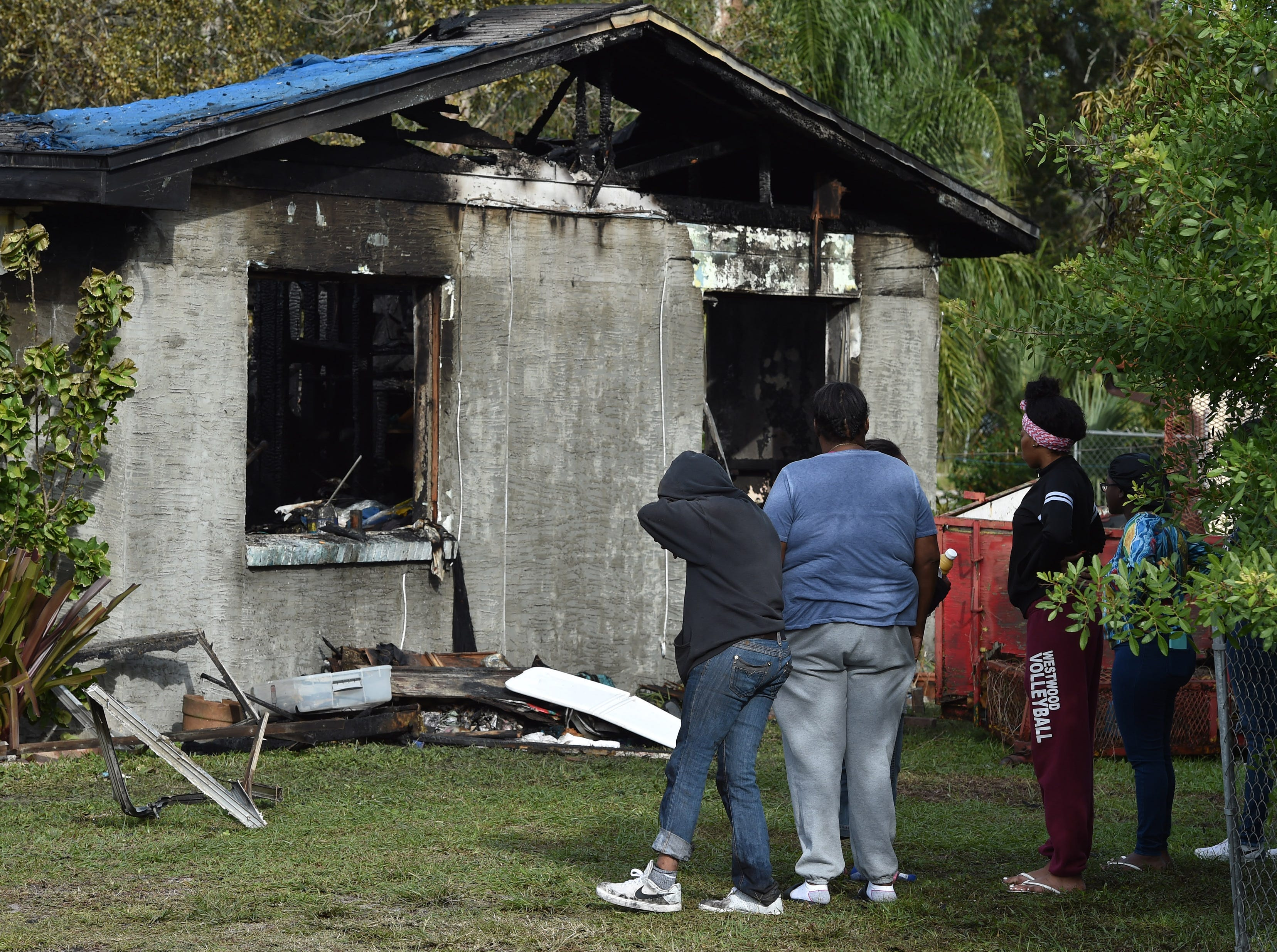 St. Lucie County Fire District firefighters sort through remains inside a home in the 2800 block of Avenue B on Friday, Nov. 30, 2018, during the investigation of the fire that completely destroyed the home shortly after 2 a.m. in Fort Pierce.