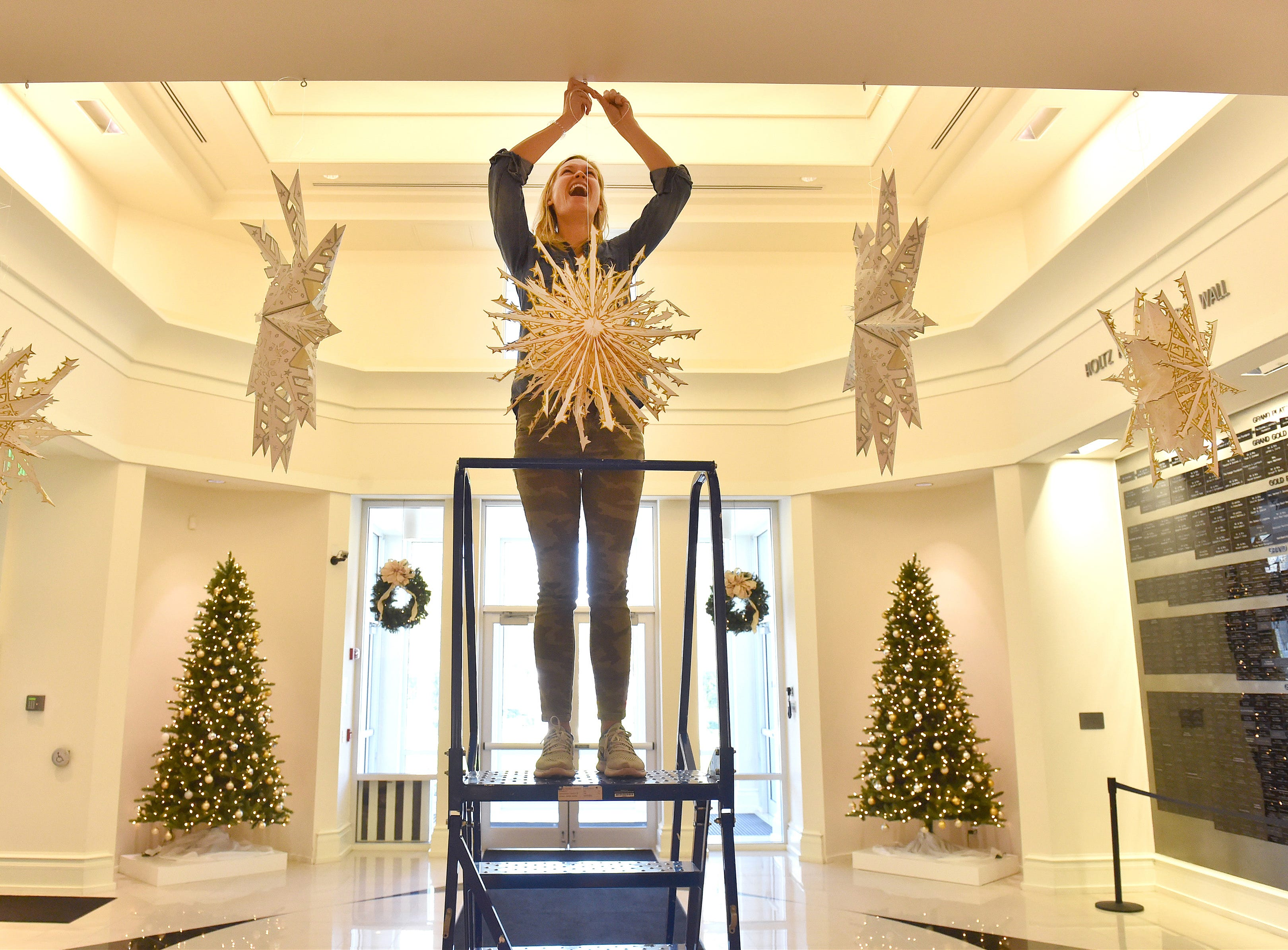 "Pamela Sommers, Youth & Family Programs Manger at the Vero Beach Museum of Art, decorates the museum's lobby on Friday, Nov. 30, 2018, in preparation for their annual Holidays at the Museum event this Sunday, Dec. 2nd, 1 p.m. to 4 p.m. at 3001 Riverside Park Drive in Vero Beach. The annual family festival this year is inspired by their Made in Germany: Art Since 1980 from the Rubell Family Collection, and will feature a variety of events throughout the holiday decorated museum during the afternoon. ""The museum has been in existence for over 30 years and we've always given back to the community and this is one of the major events that we host every year that does exactly that,"" said Sophie Bentham-Wood, Director of Marketing and Communications at the museum. ""It's a free admission day that allows everyone who is part of our community to come and enjoy all the exhibitions and all the educational programs that we can offer throughout the year."" The museum store will be offering a 20 percent discount on all holiday themed merchandise during the event."