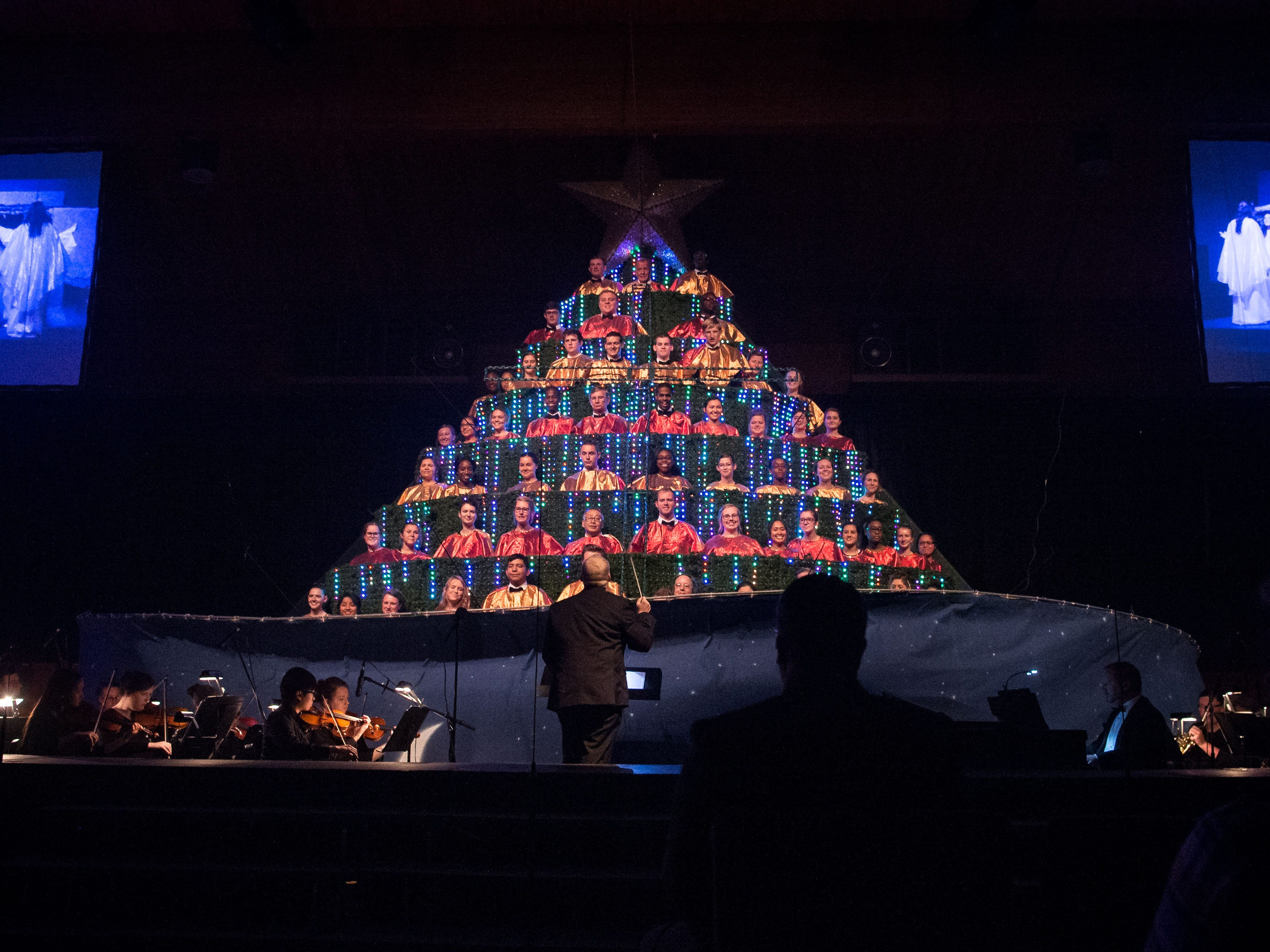 "The Singing Christmas Tree is revealed for the first time on opening night at Hobe Sound Ministries' 22nd annual Christmas program, ""Jesus, What a Beautiful Name,"" on Nov. 29, 2018, at the Hobe Sound Bible College and Church in Hobe Sound. The program runs nightly at 7 p.m. through Dec. 2."