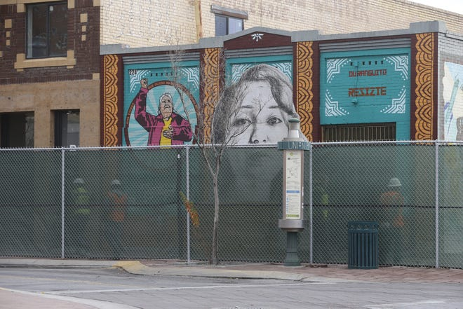 The city installed fencing around much of the Duranguito neighborhood in Downtown El Paso in preparation for the possible future demolition of buildings to make way for a proposed multipurpose arena.