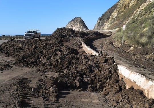 A 2015 photo showing mud that had flooded Pacific Coast Highway weeks during a storm weeks earlier.