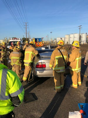 Ventura County and Oxnard fire crews worked to pull a person from a vehicle Thursday after a vehicle crash into a power pole.
