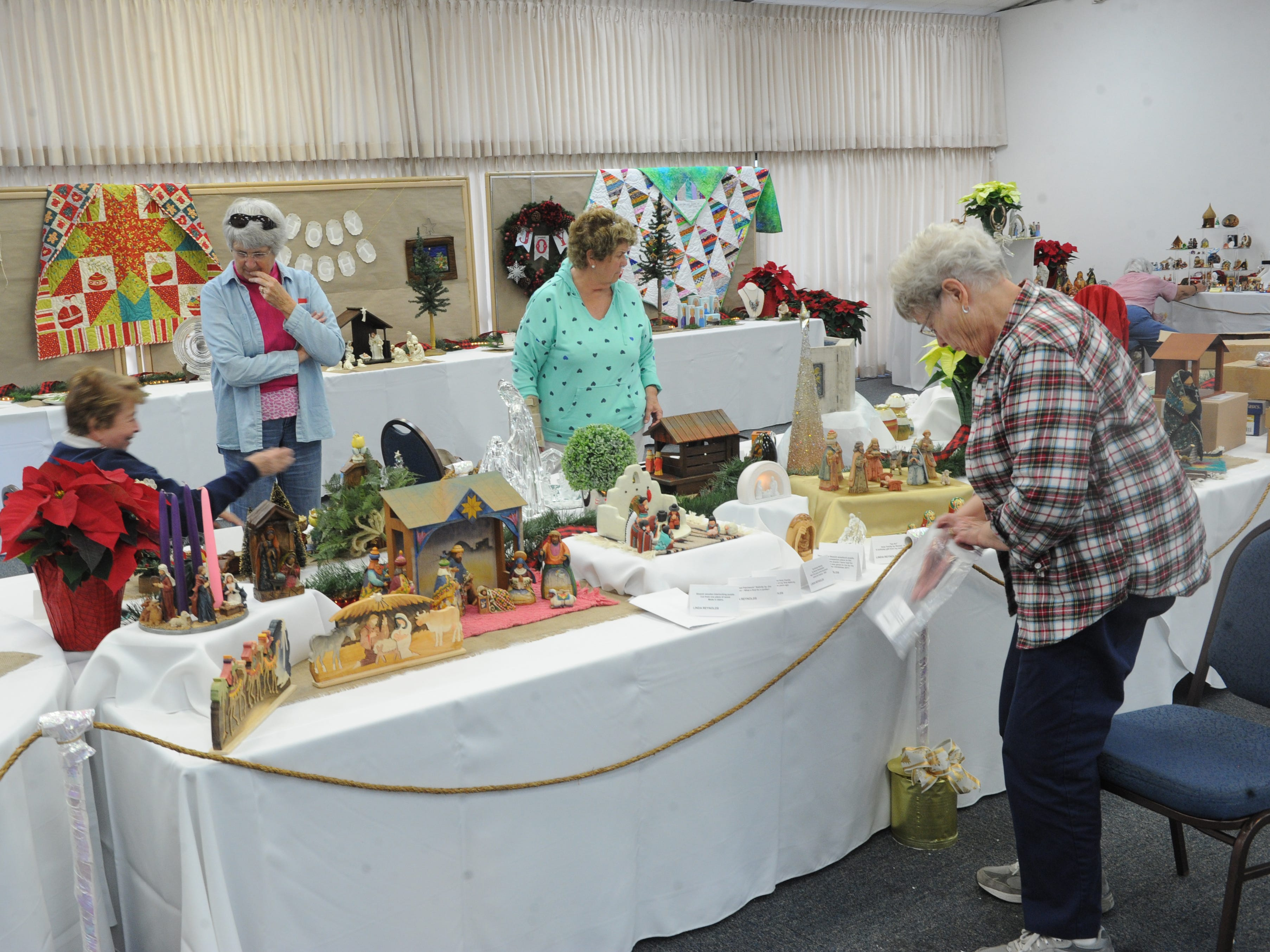 People set up Nativity displays for No Room at the Inn at the Camarillo United Methodist Church. The display runs through Sunday.