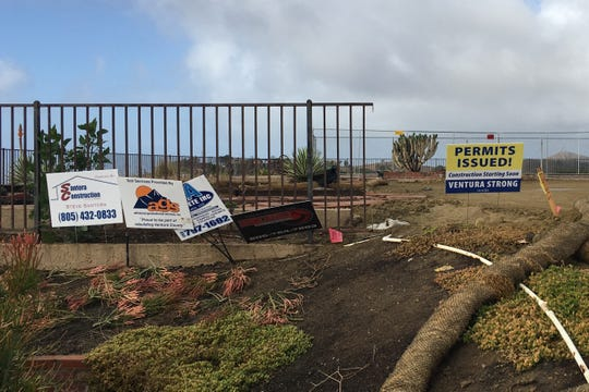 The city has issued 133 rebuilding permits as the one-year anniversary of the Thomas Fire approaches. A homeowner gets a sign to show construction can start.
