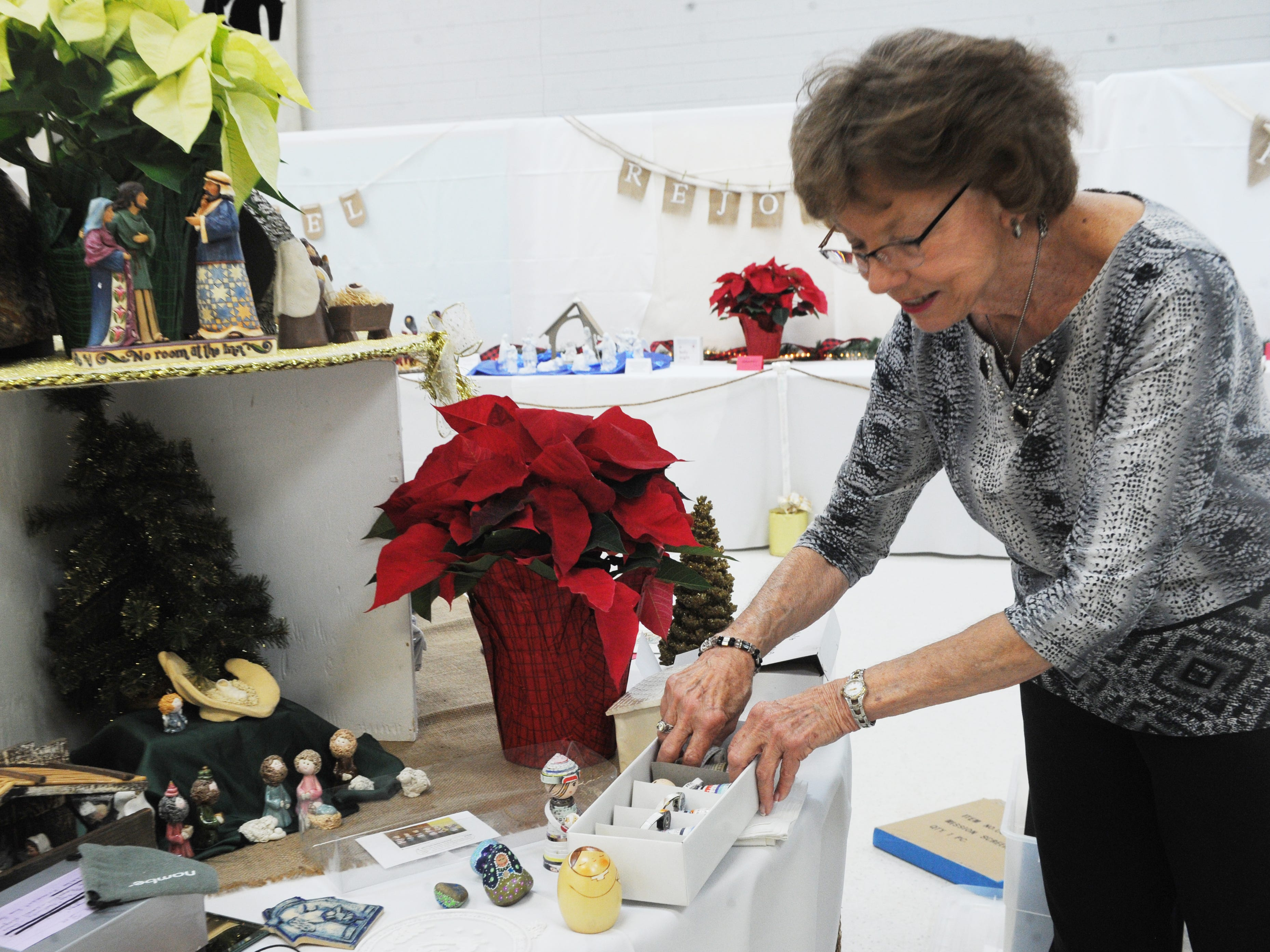 Nora Howells, co-founder of No Room at the Inn, sets up a Nativity scene at the Camarillo United Methodist Church.