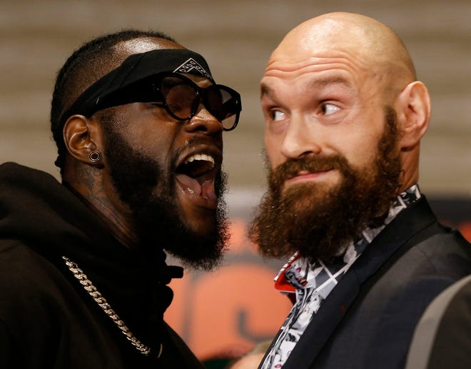 Deontay Wilder, left, and Tyson Fury didn't exactly eye to eye during Wednesday's news conference in Long Angeles. The two will settle their differences in the ring Saturday night.