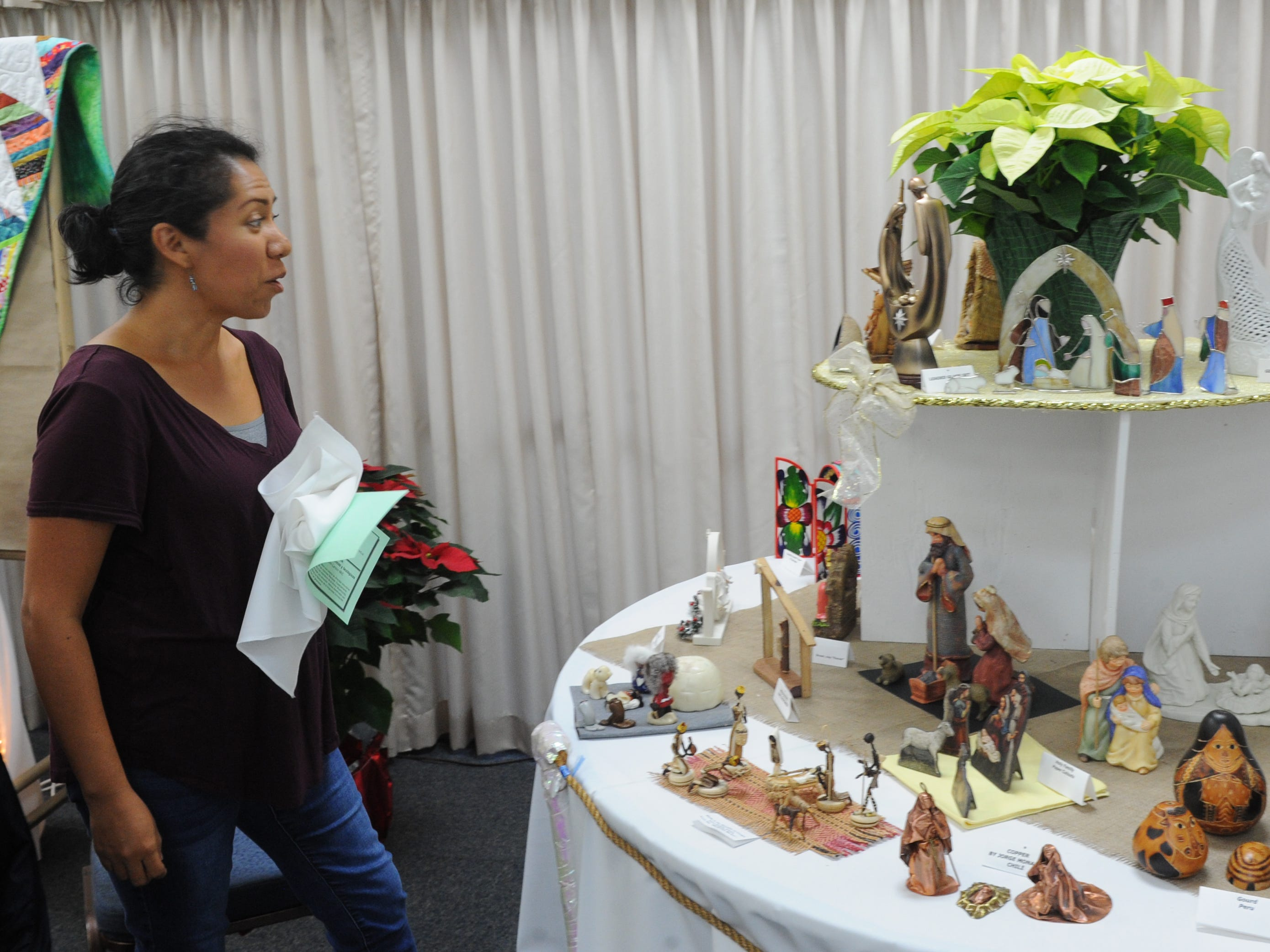 Yenelli Law admires a Nativity scene at the Camarillo United Methodist Church. A display runs through Sunday.