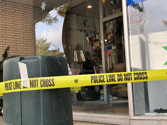 Police tape secures a broken window at Beatwear in downtown Visalia on Friday, November 30, 2018. The dancewear and law enforcement uniform supply store was burglarized early Friday morning.