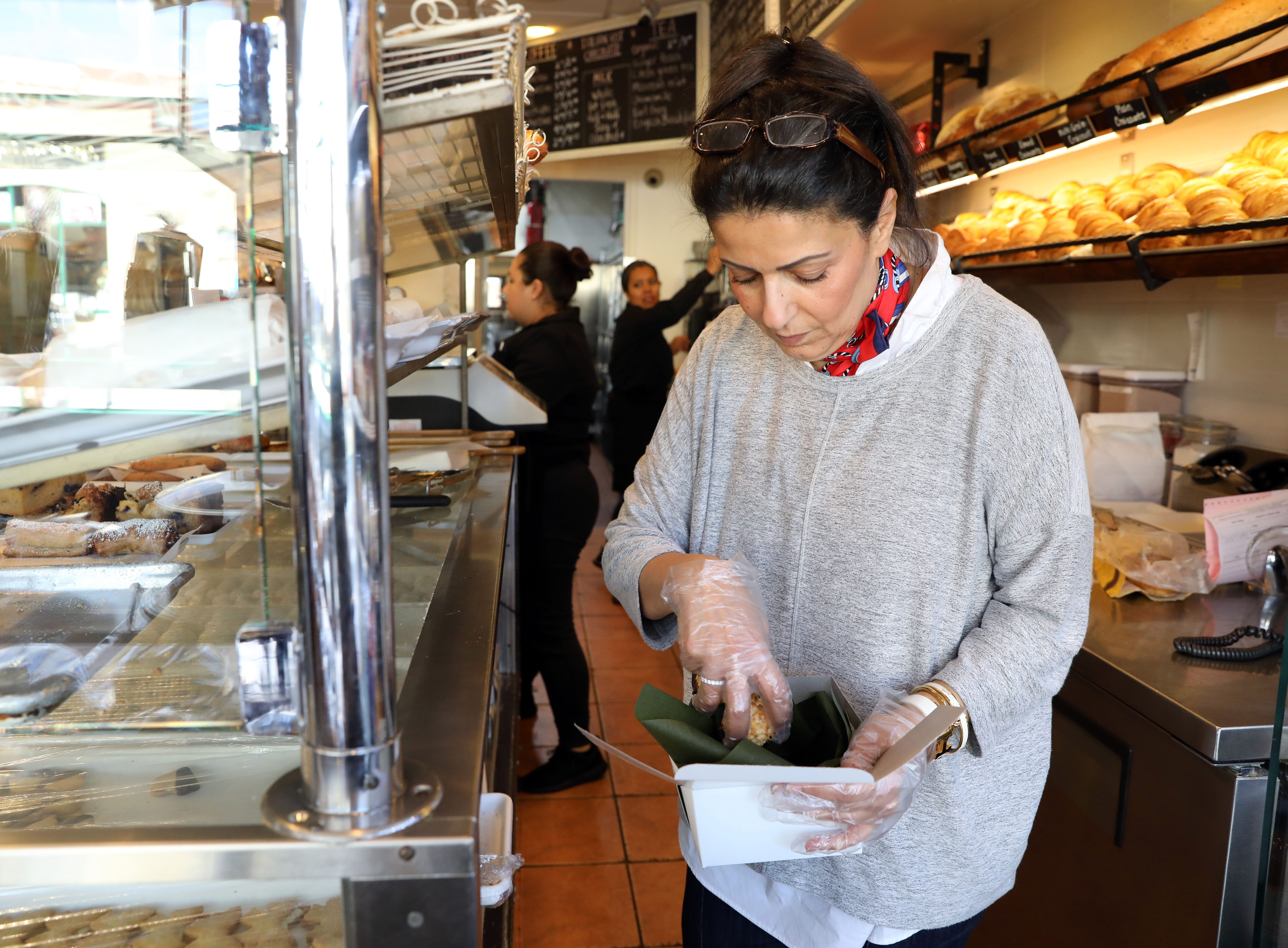 Co-owner Tal Campana boxes cookies at Martine's Fine Bake Shoppe in Tuckahoe Nov. 29, 2018. The family bakery, which has a second location in Scarsdale, is celebrating their 10th anniversary in business.