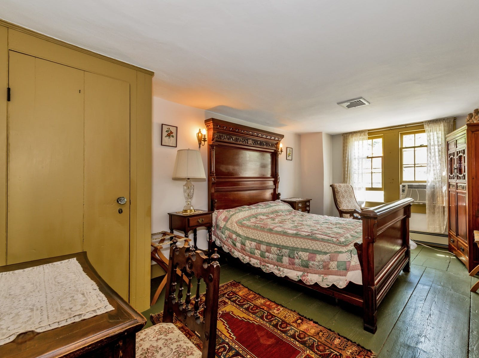There are original details including hand-hewn beams and wide-plank floors.