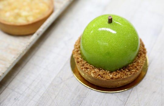 An apple tart known as the Carmen, is prepared at Martine's Fine Bake Shop in Tuckahoe Nov. 29, 2018.