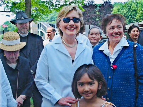 Hillary Clinton poses for a photo with then 5-year-old Sanjana Ramaswamy in 2006 in Chappaqua. Congresswoman Nita Lowey is standing next to them.