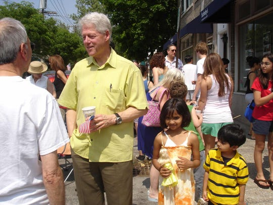 Bill Clinton talks to residents at Memorial Day parade in 2006. The Ramaswamy kids, Sanjana, 5, and Krishna, 3, stand close by.