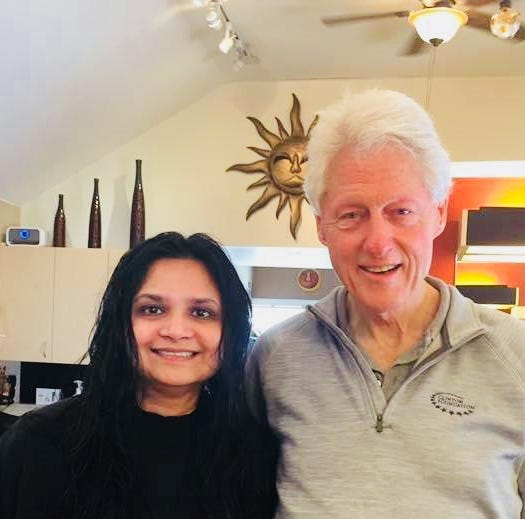 Lohud's Swapna Venugopal Ramaswamy with Bill Clinton, who unexpectedly stopped by at a Chappaqua beauty parlor.