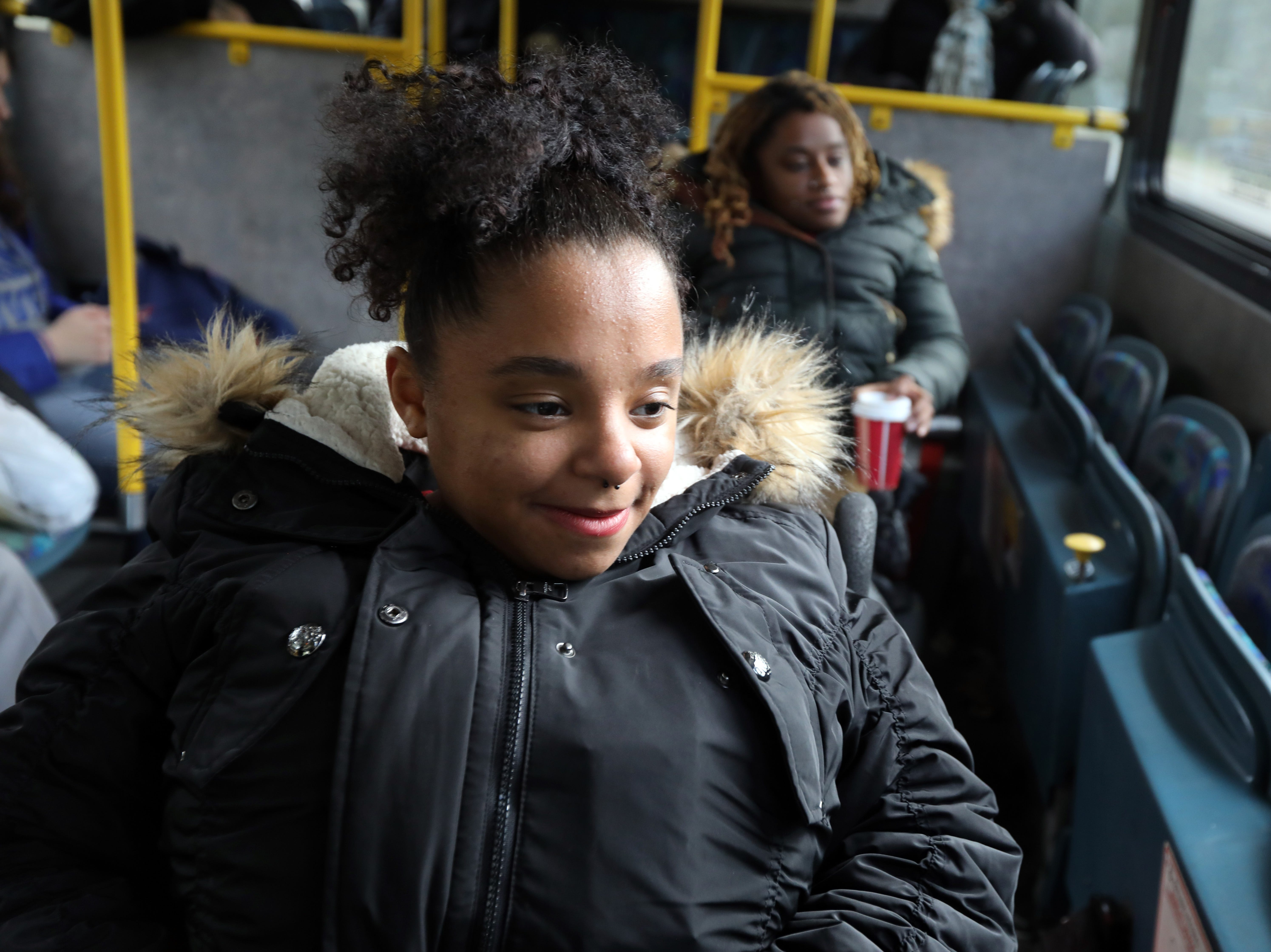 Zasia Davis, 22, left, and her sister Diana Bouknight, 28, ride the bus home after working at the Target in Spring Valley Nov. 27, 2018.