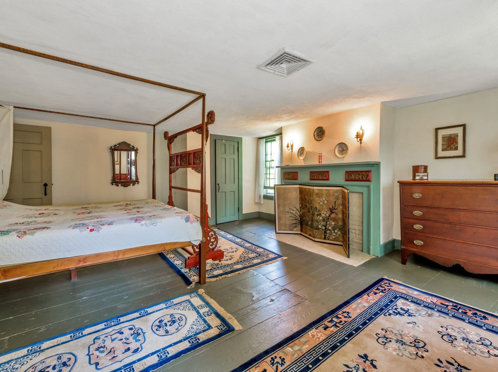 There are many original details including wide-plan wood floors. The home has an original mantelpiece, brought over from England.