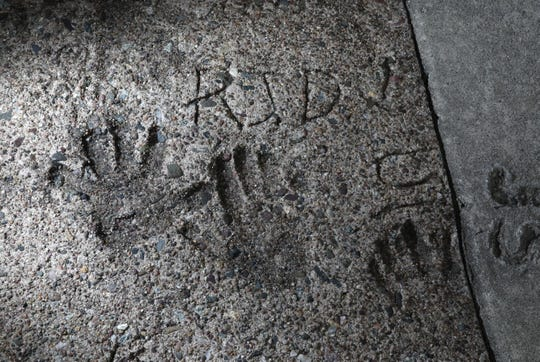 The initials RJD can be seen in handprints set in concrete at The Shops at Nanuet Nov. 30, 2018. The handprints were done by children attending opening ceremonies for Bamberger's opening in 1969.