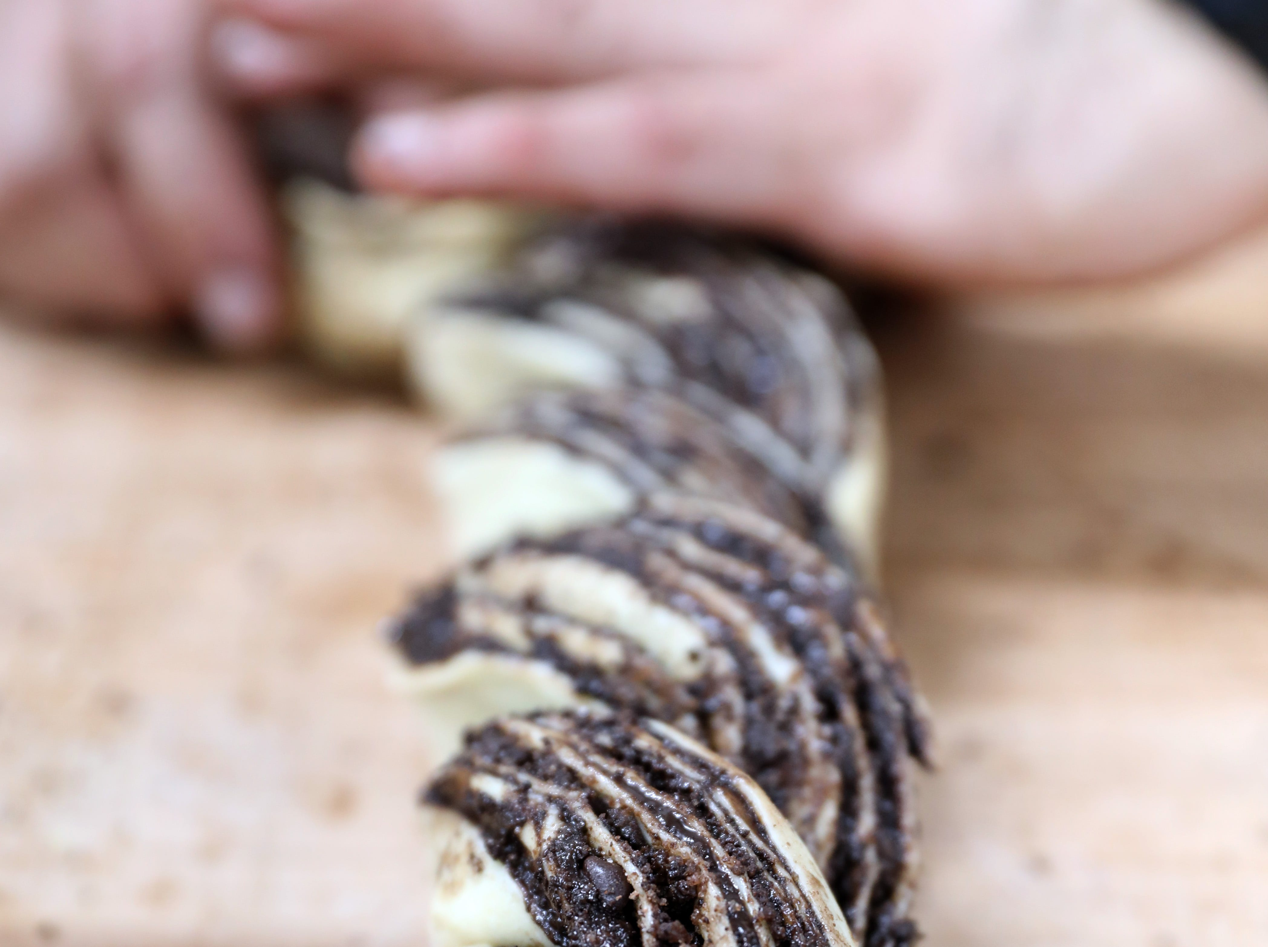 A chocolate babka is braided at Martine's Fine Bake Shoppe in Tuckahoe Nov. 29, 2018. The family bakery, which has a second location in Scarsdale, is celebrating their 10th anniversary in business.